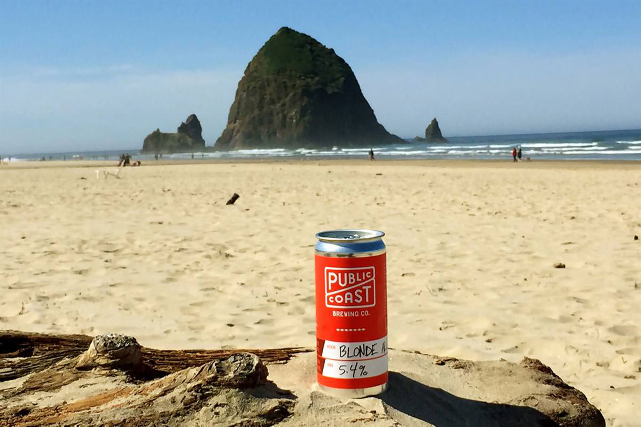 Public Coast Blonde Ale on the beach with Haystack Rock